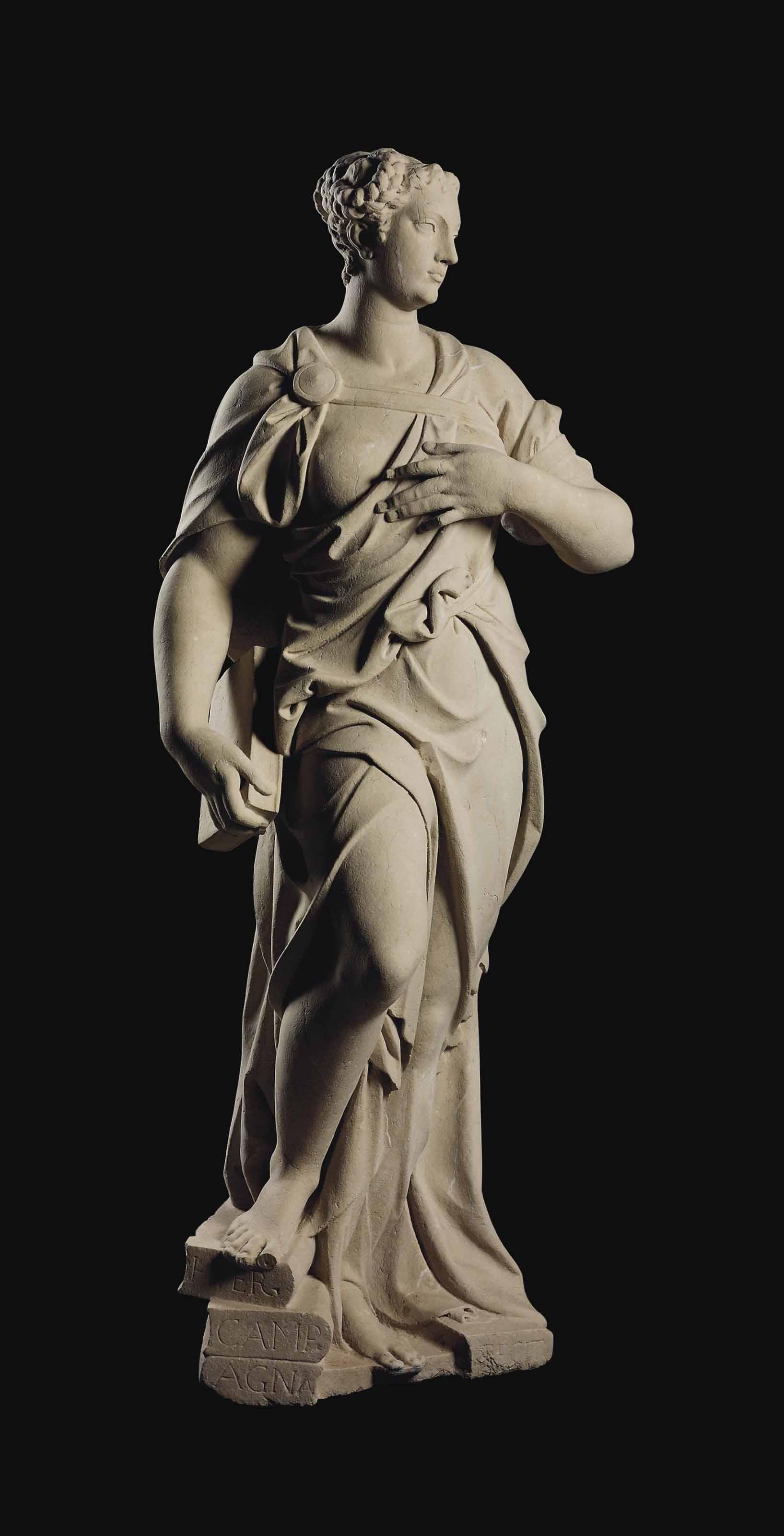 A CARVED STONE FEMALE ALLEGORI