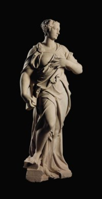 A CARVED STONE FEMALE ALLEGORICAL FIGURE