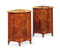 A PAIR OF LOUIS XV ORMOLU-MOUNTED TULIPWOOD ENCOIGNURES