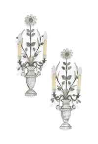 A PAIR OF FRENCH SILVERED-METAL PRESSED AND CUT-GLASS TWIN-BRANCH WALL APPLIQUES