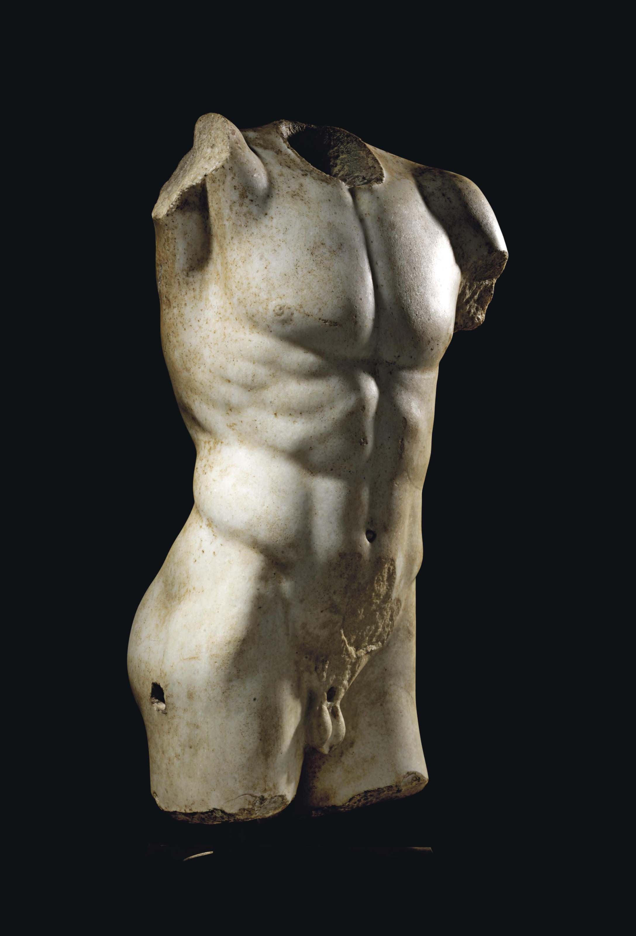 A ROMAN MARBLE TORSO OF AN ATHLETE