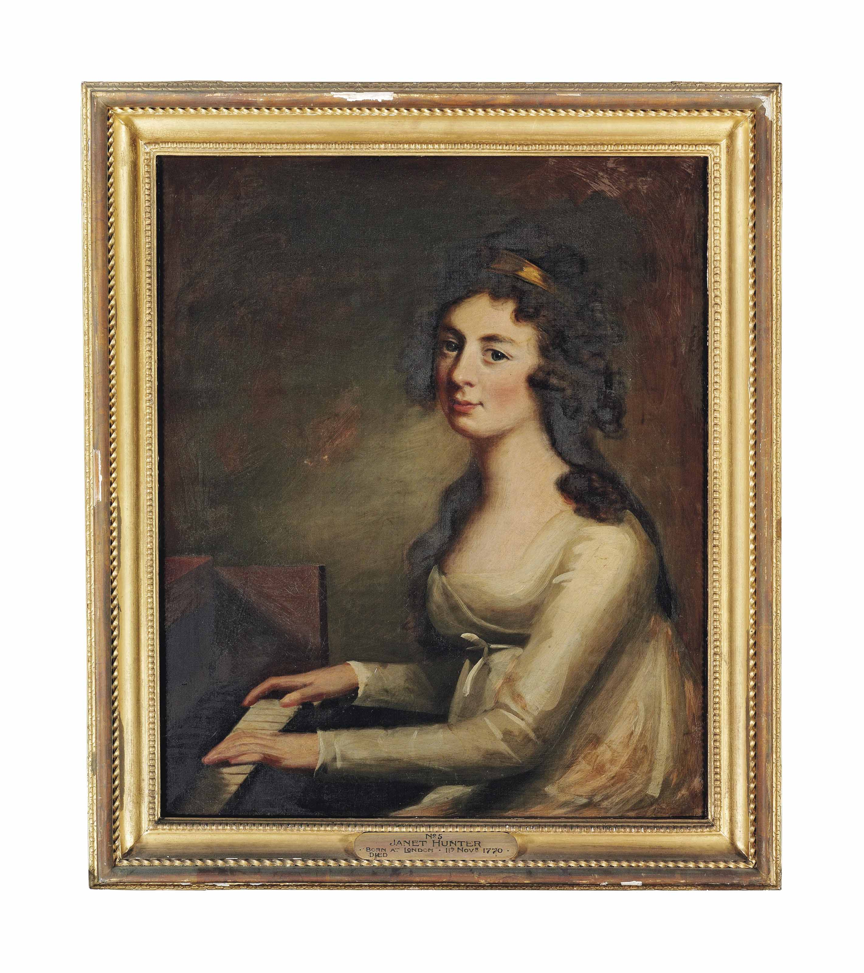 Portrait of Janet Hunter, half-length, in a white dress, seated at a piano