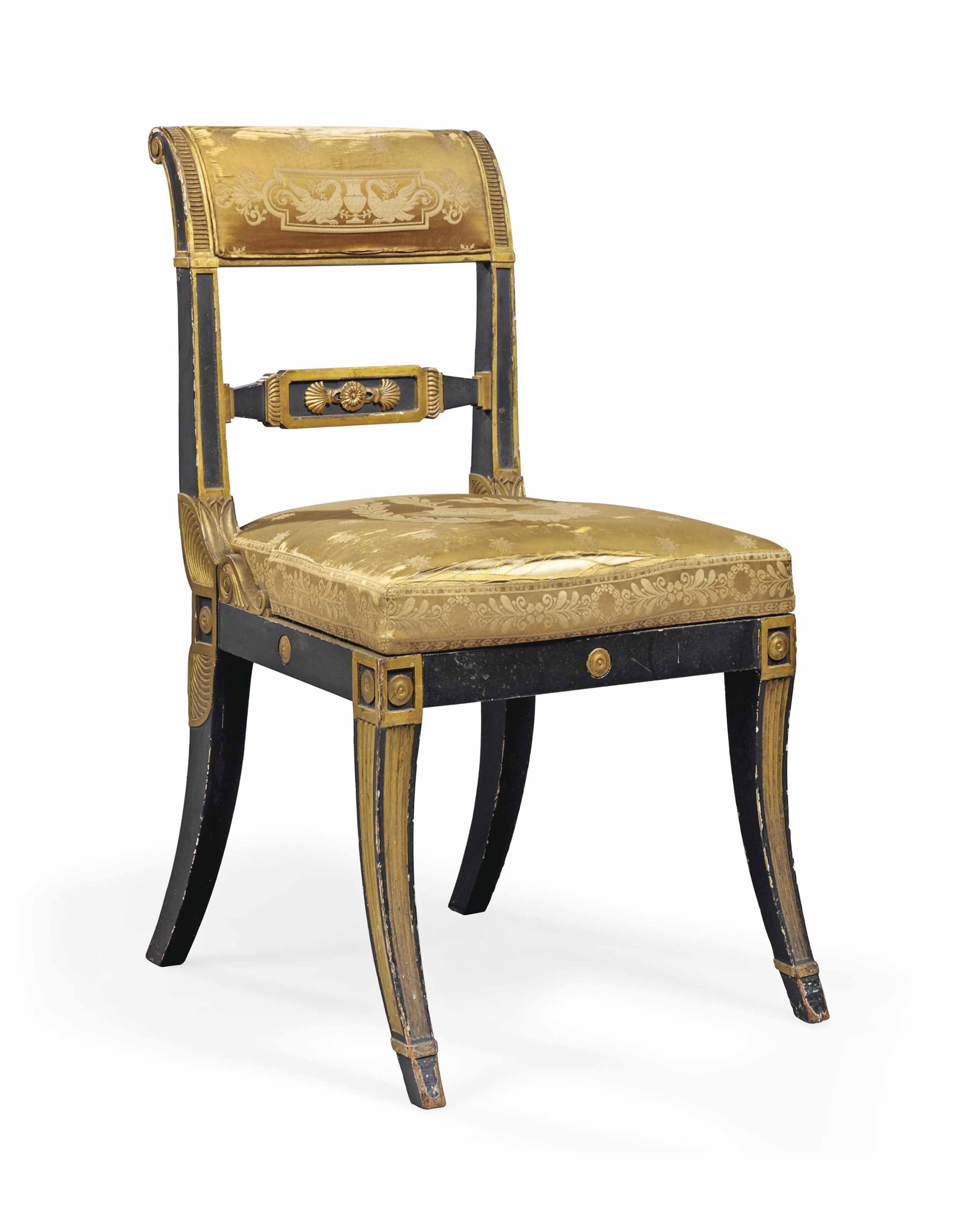 A REGENCY PARCEL-GILT AND EBONISED SIDE CHAIR