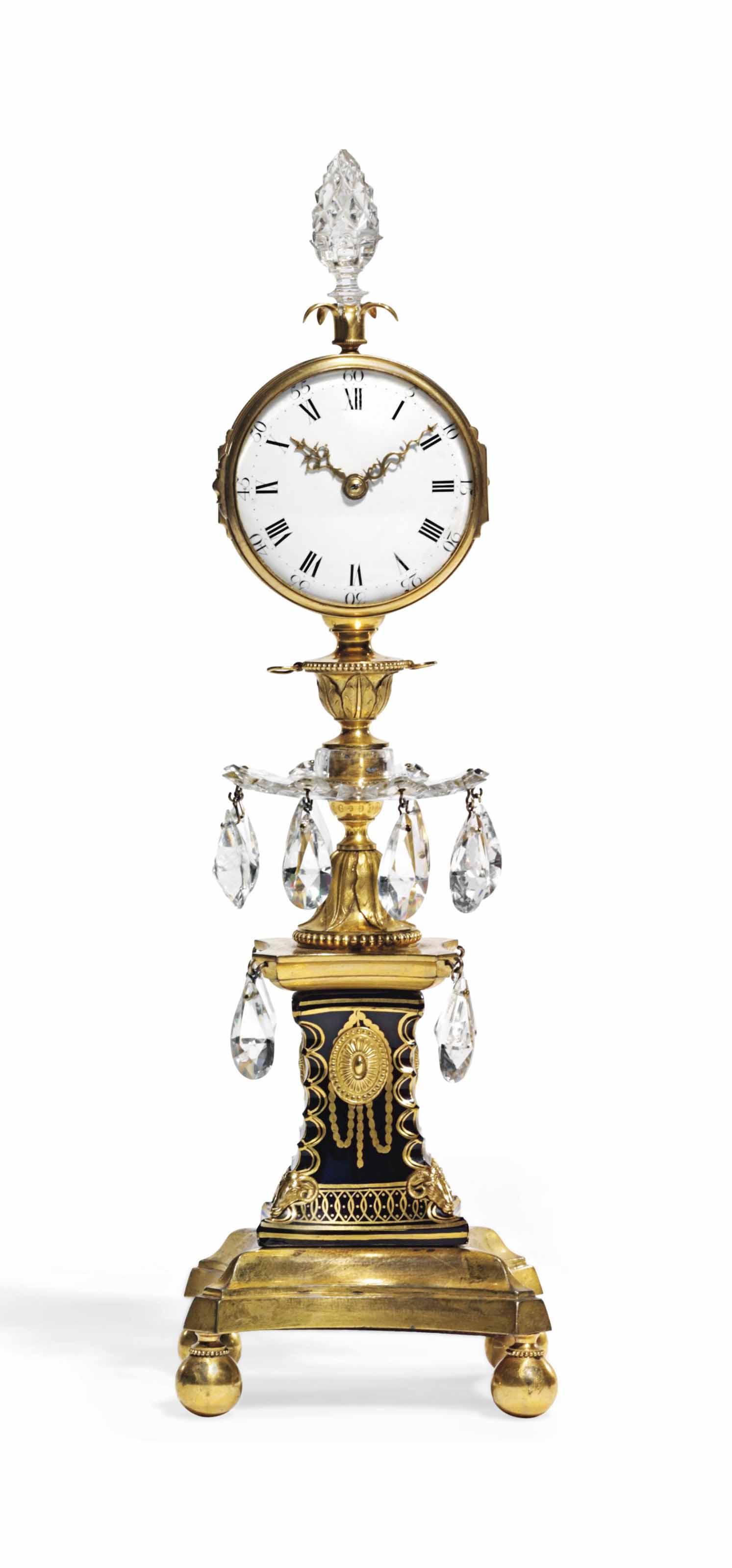 AN UNUSUAL GEORGE III ORMOLU AND CUT GLASS 'CANDLESTICK CLOCK' TIMEPIECE