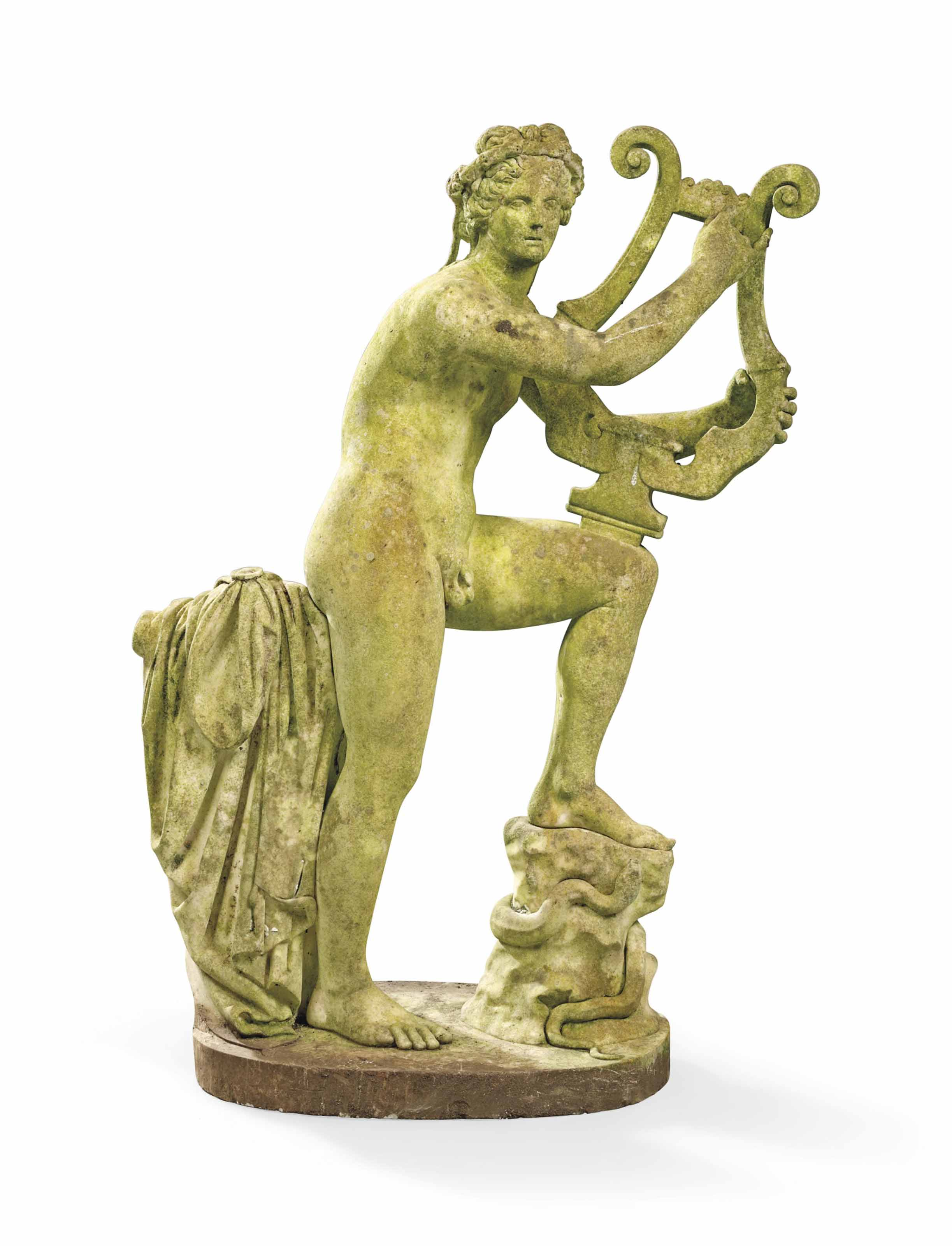 A CARVED MARBLE FIGURE OF APOLLO PLAYING HIS LYRE