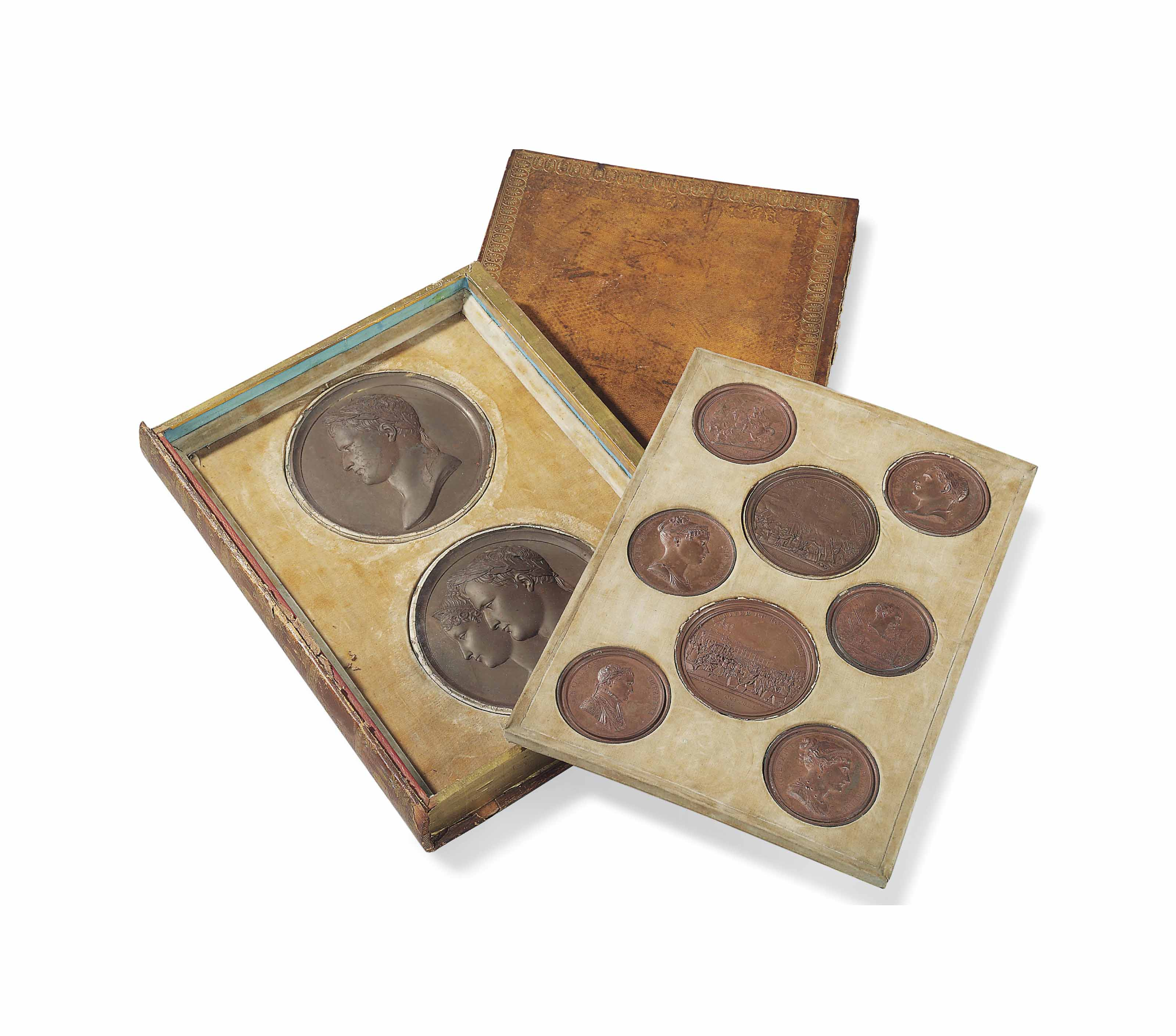 A CASED SET OF TEN CIRCULAR PATINATED LEAD 'NAPOLEON MEDALS'