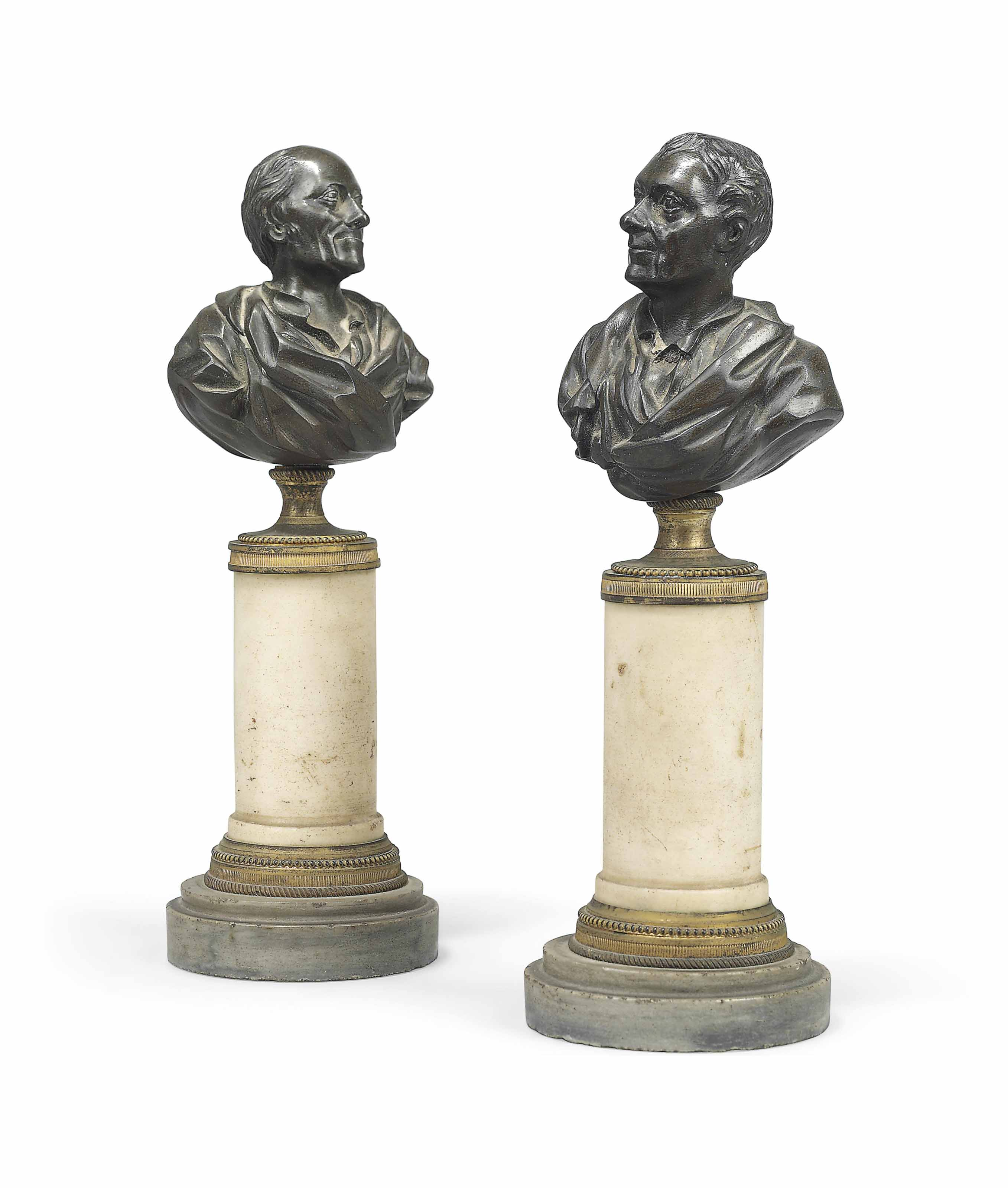 A PAIR OF BRONZE BUSTS OF VOLTAIRE AND ROUSSEAU