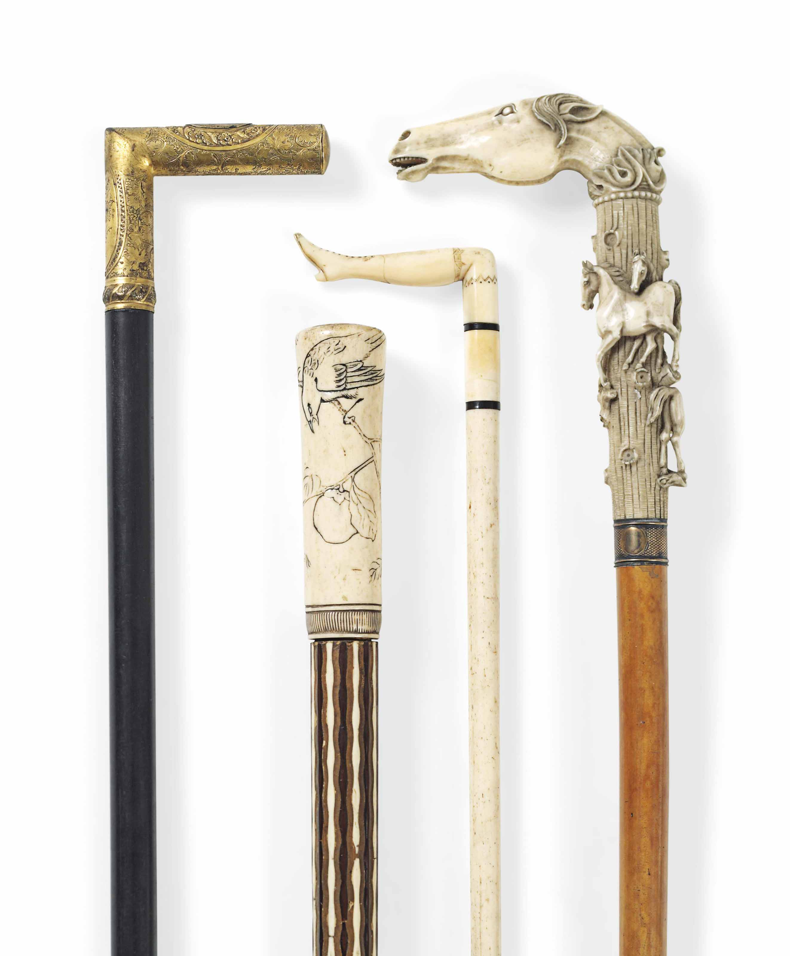 A COLLECTION OF FOUR WALKING CANES