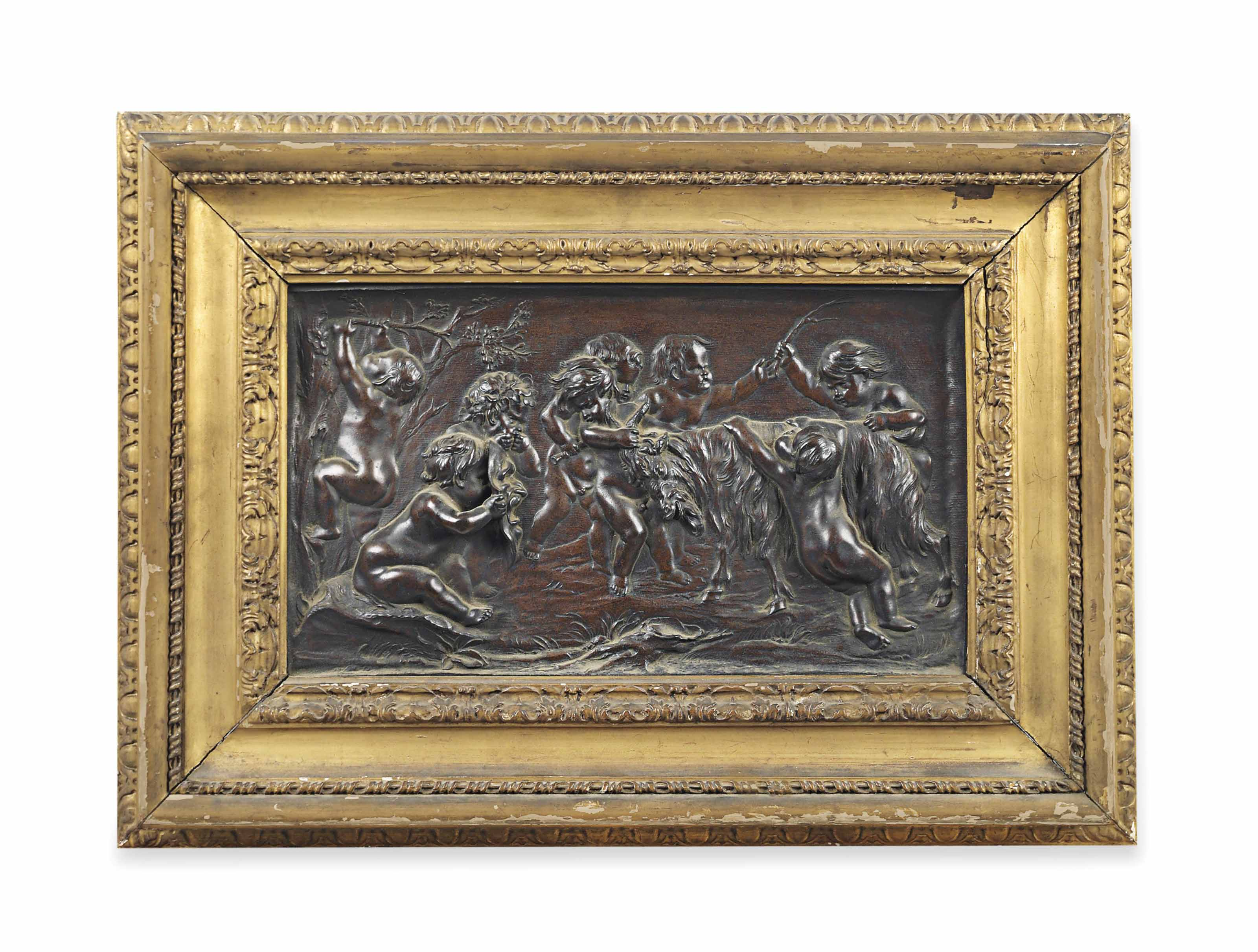 A RECTANGULAR BRONZE RELIEF OF BACCHANALIAN INFANTS PLAYING WITH A GOAT