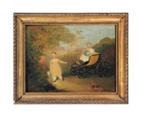 Two children playing on a 'go-cart' in a landscape