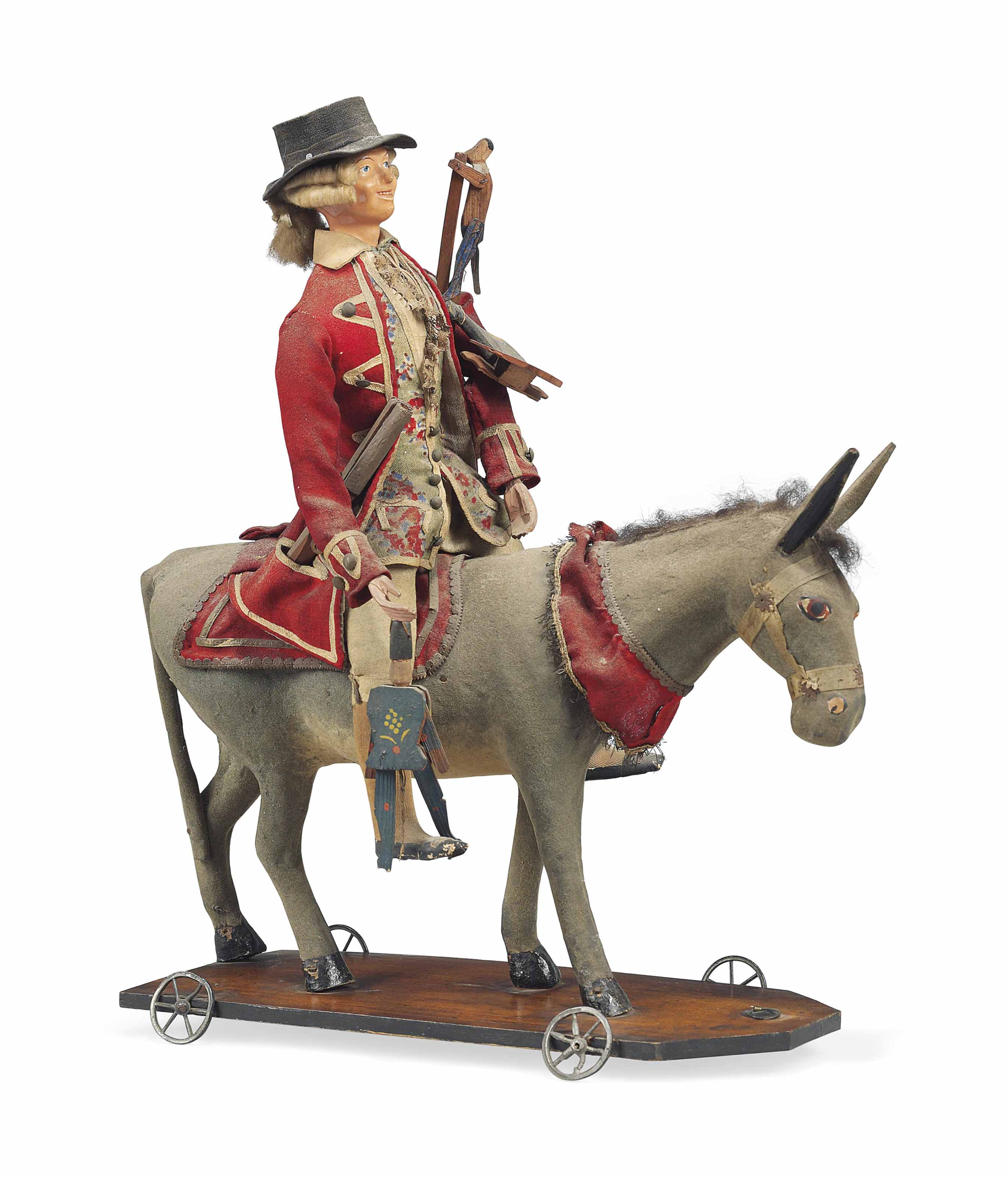 A PAPIER MACHE AND WOOD FIGURE OF A TOY-PEDLAR ON A DONKEY