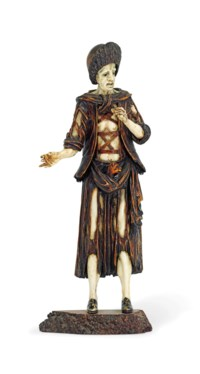 A CARVED IVORY AND WALNUT FIGURE OF A TRAVELLER