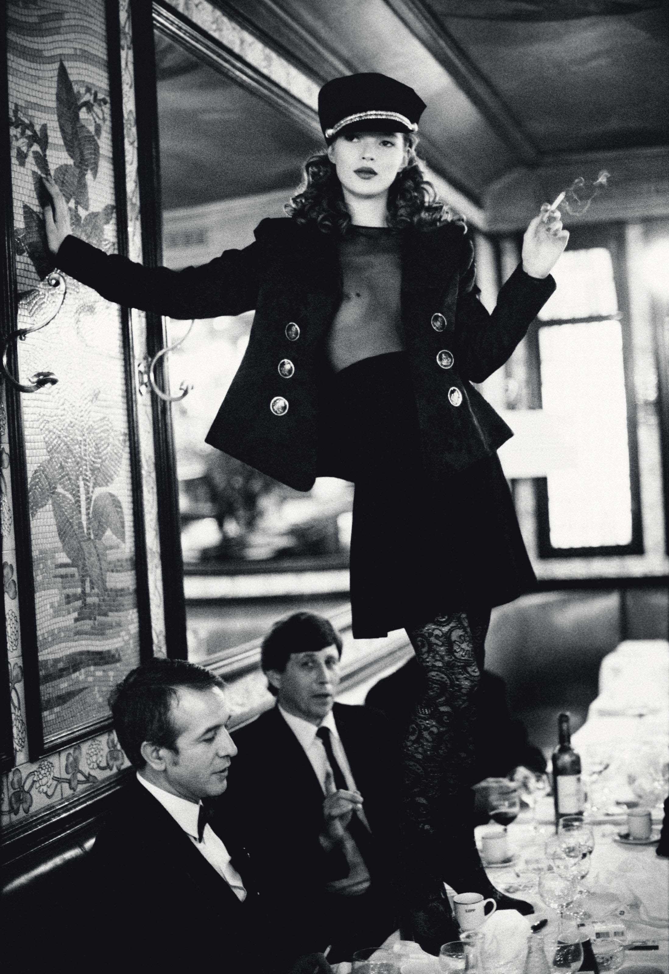 Kate Moss at Brasserie Lipp, Paris, for Italian Vogue, September 1993