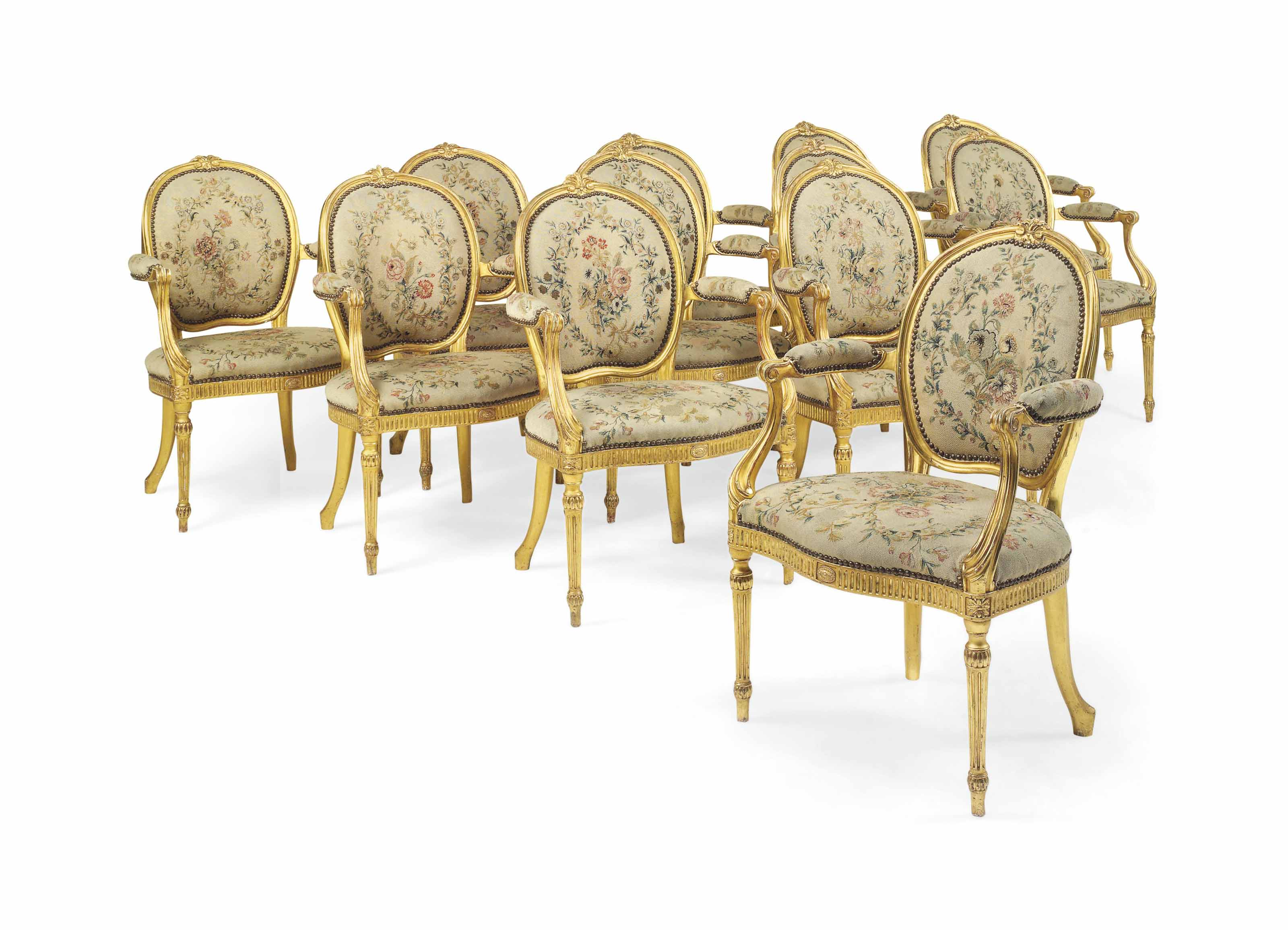 A SET OF TWELVE GEORGE III GILTWOOD OPEN ARMCHAIRS