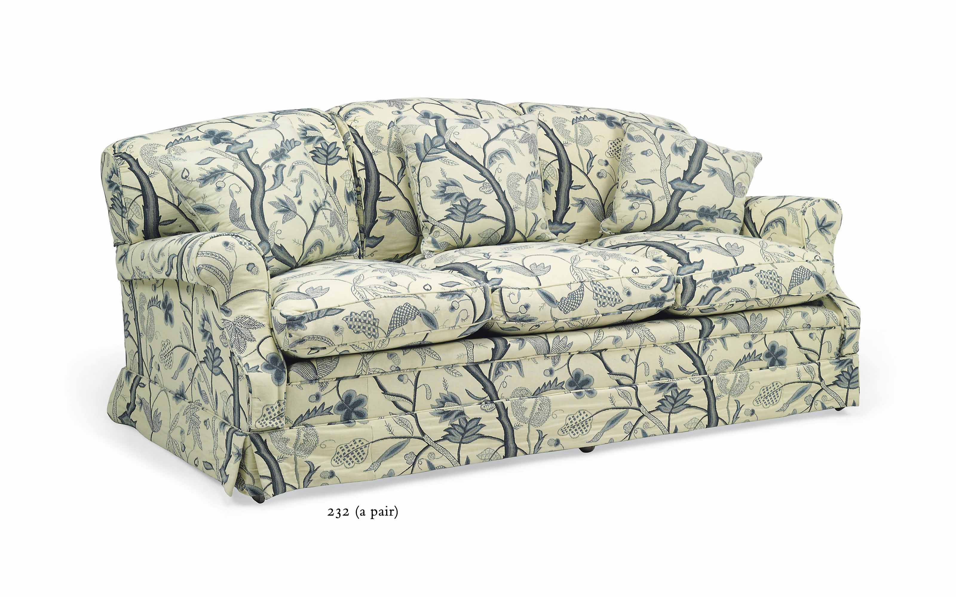 A PAIR OF 'HOWARD' CREWELWORK THREE-SEAT SOFAS