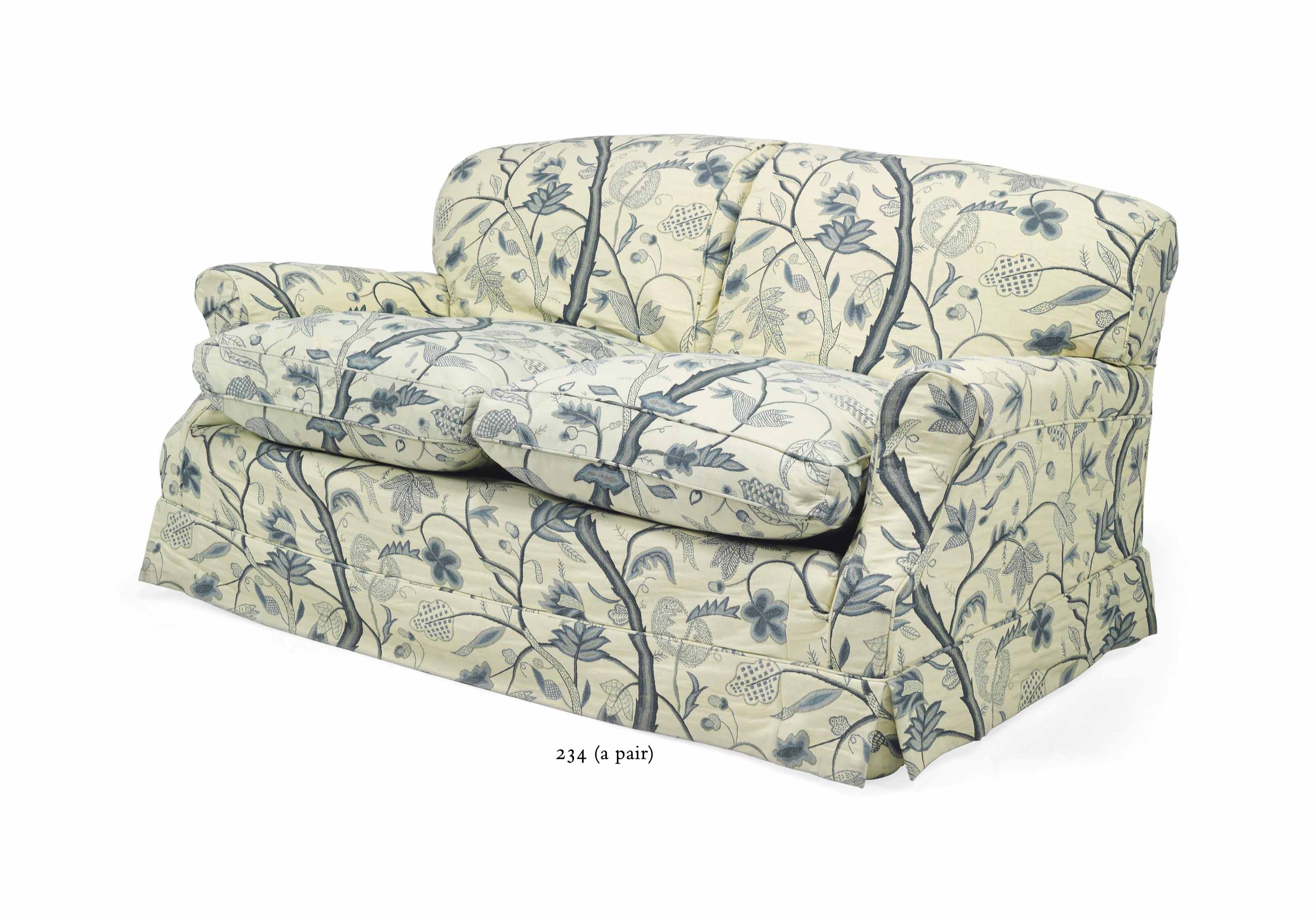 A PAIR OF 'HOWARD' CREWELWORK TWO-SEAT SOFAS