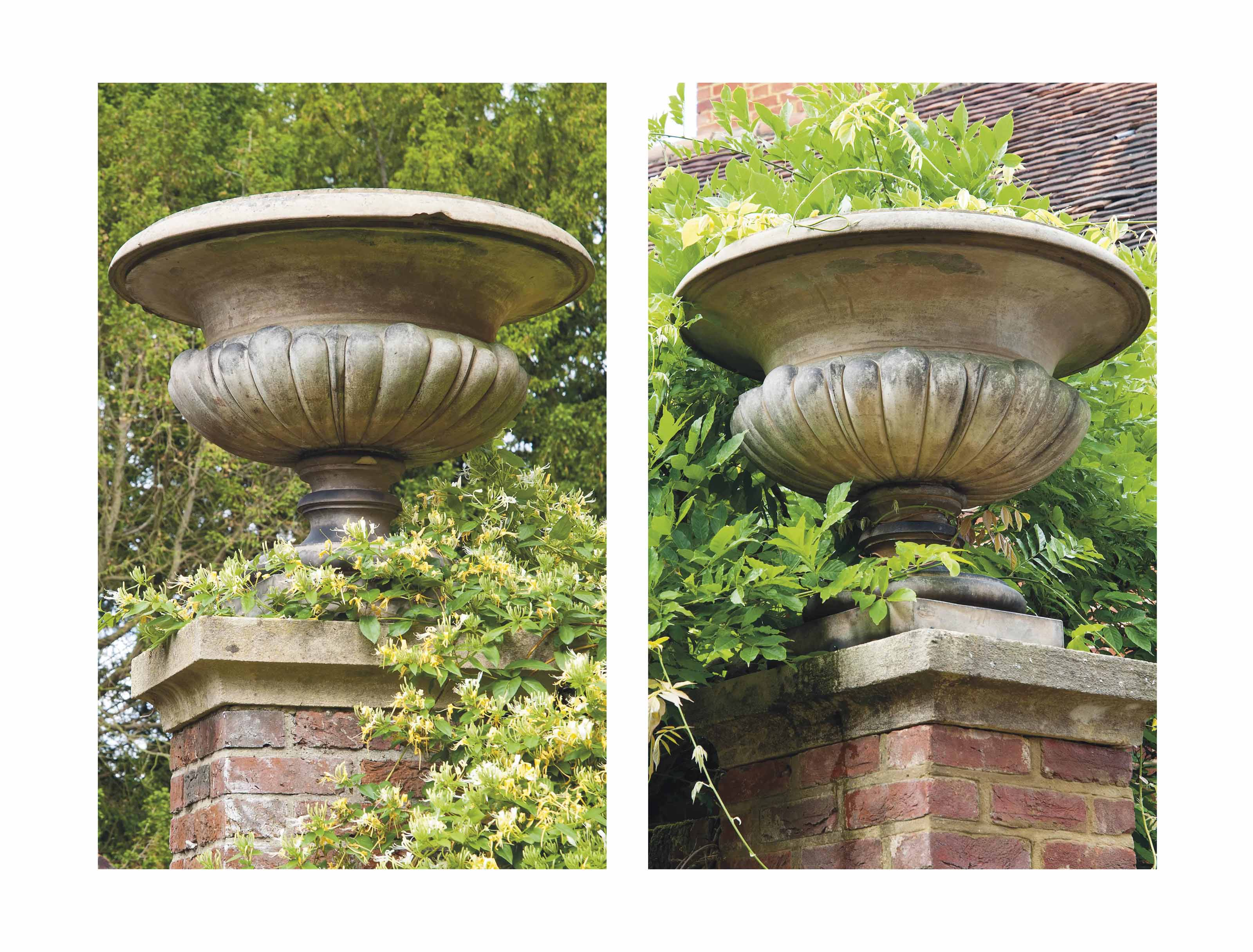 A PAIR OF VICTORIAN TERRACOTTA URNS