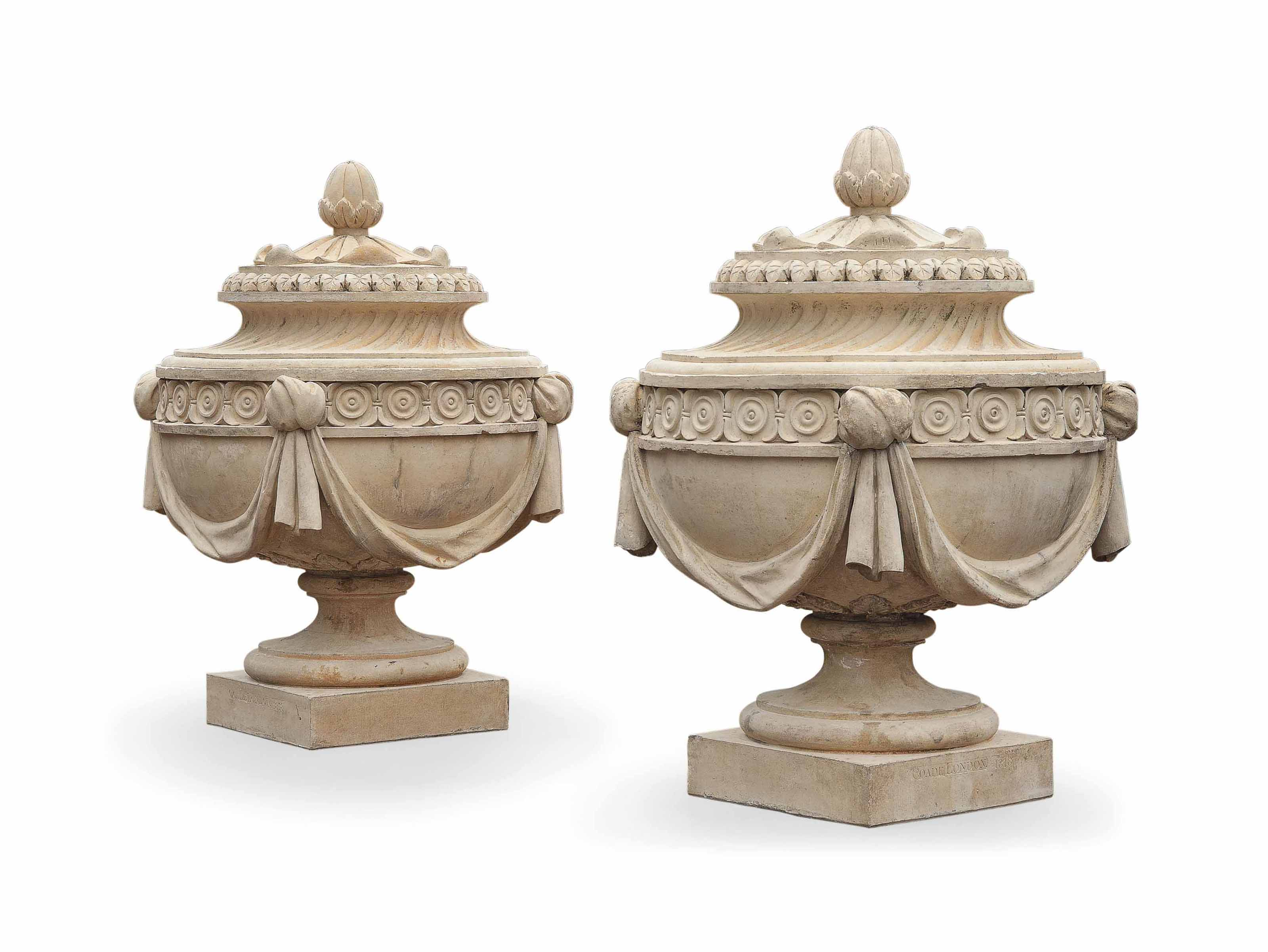 A PAIR OF GEORGE III ARTIFICIAL 'COADE' STONE FINIALS