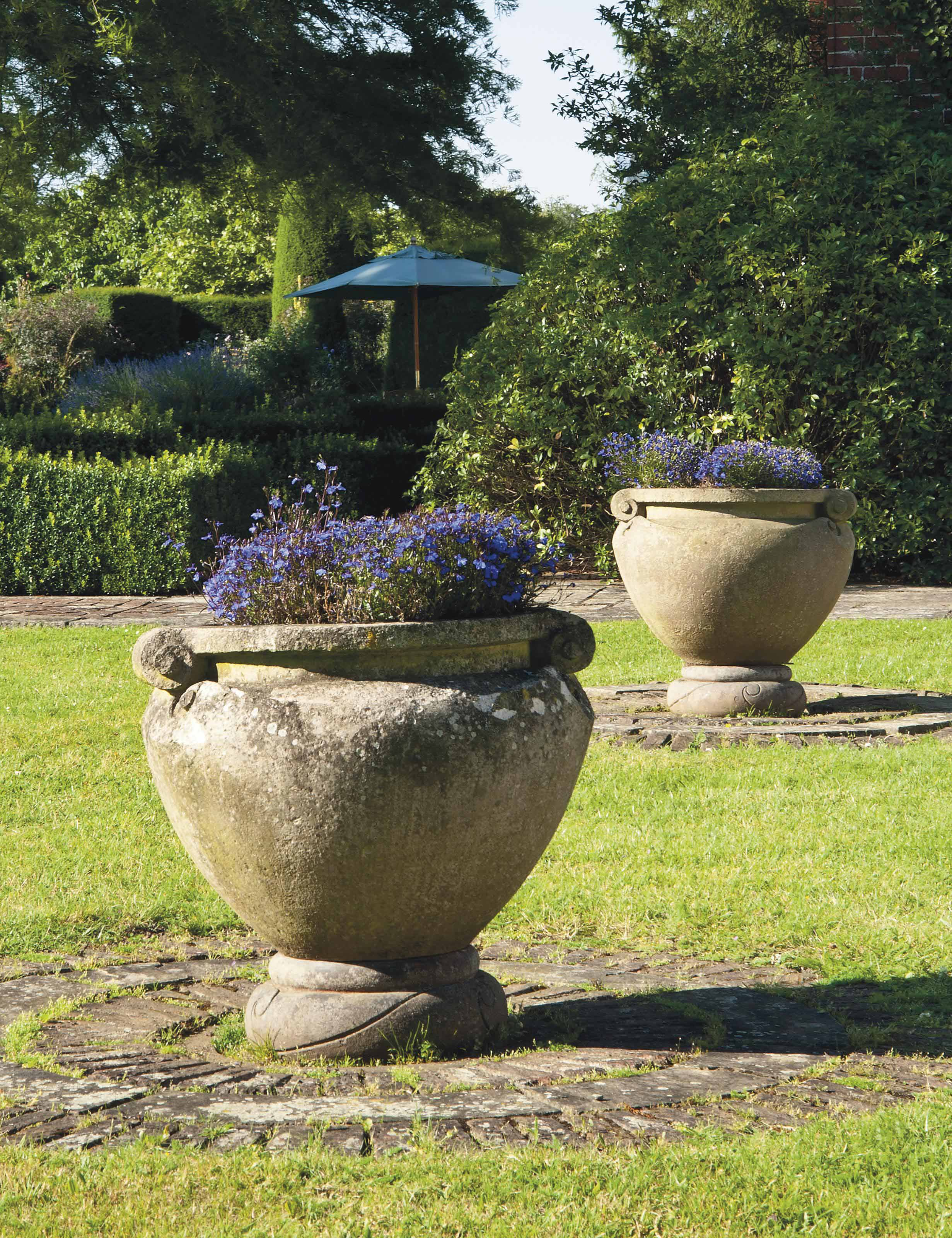 A MATCHED PAIR OF TERRACOTTA 'SCROLL' POTS