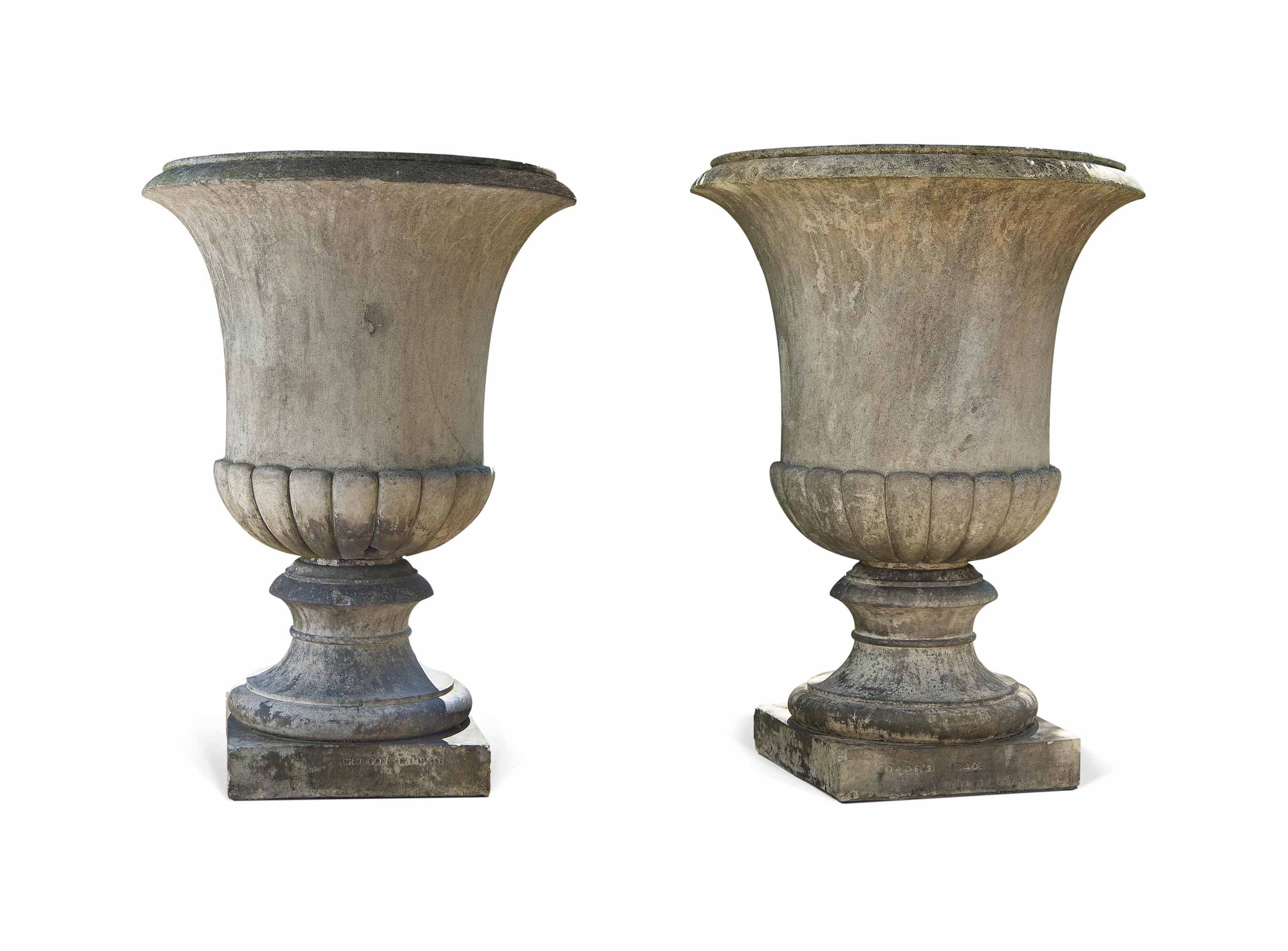 A MATCHED PAIR OF ARTIFICIAL 'COADE' STONE URNS
