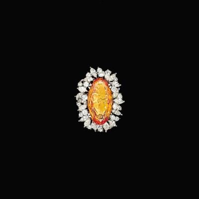 An orange topaz and diamond cl