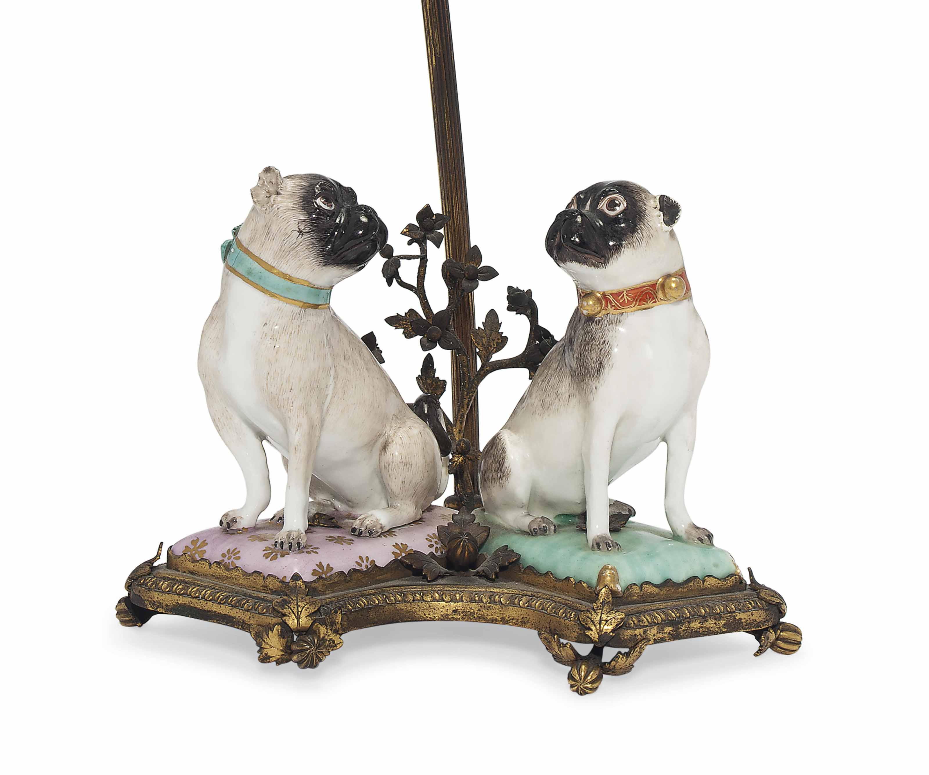 A PAIR OF MEISSEN MODELS OF SEATED PUG-DOGS