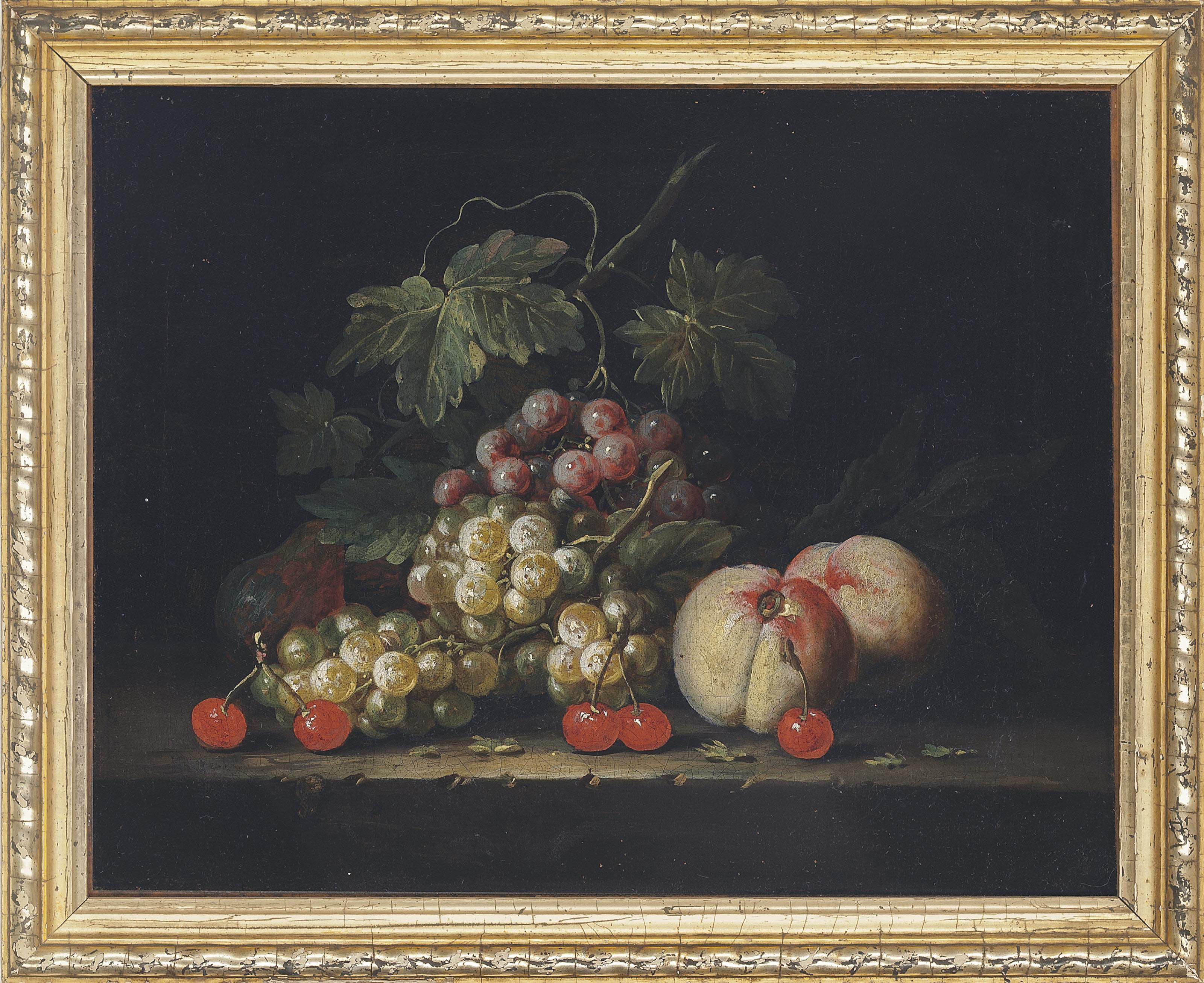 Grapes, peaches and cherries on a stone ledge
