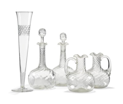 A PAIR OF MOULDED GLASS DECANT