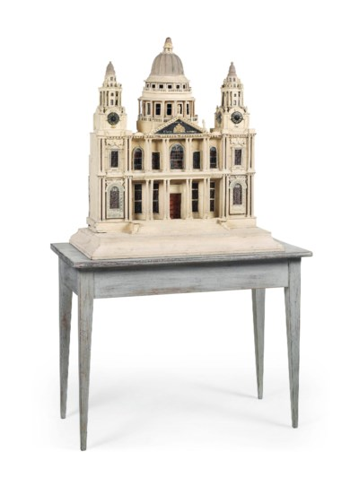 A PAINTED CARD AND WOOD MODEL