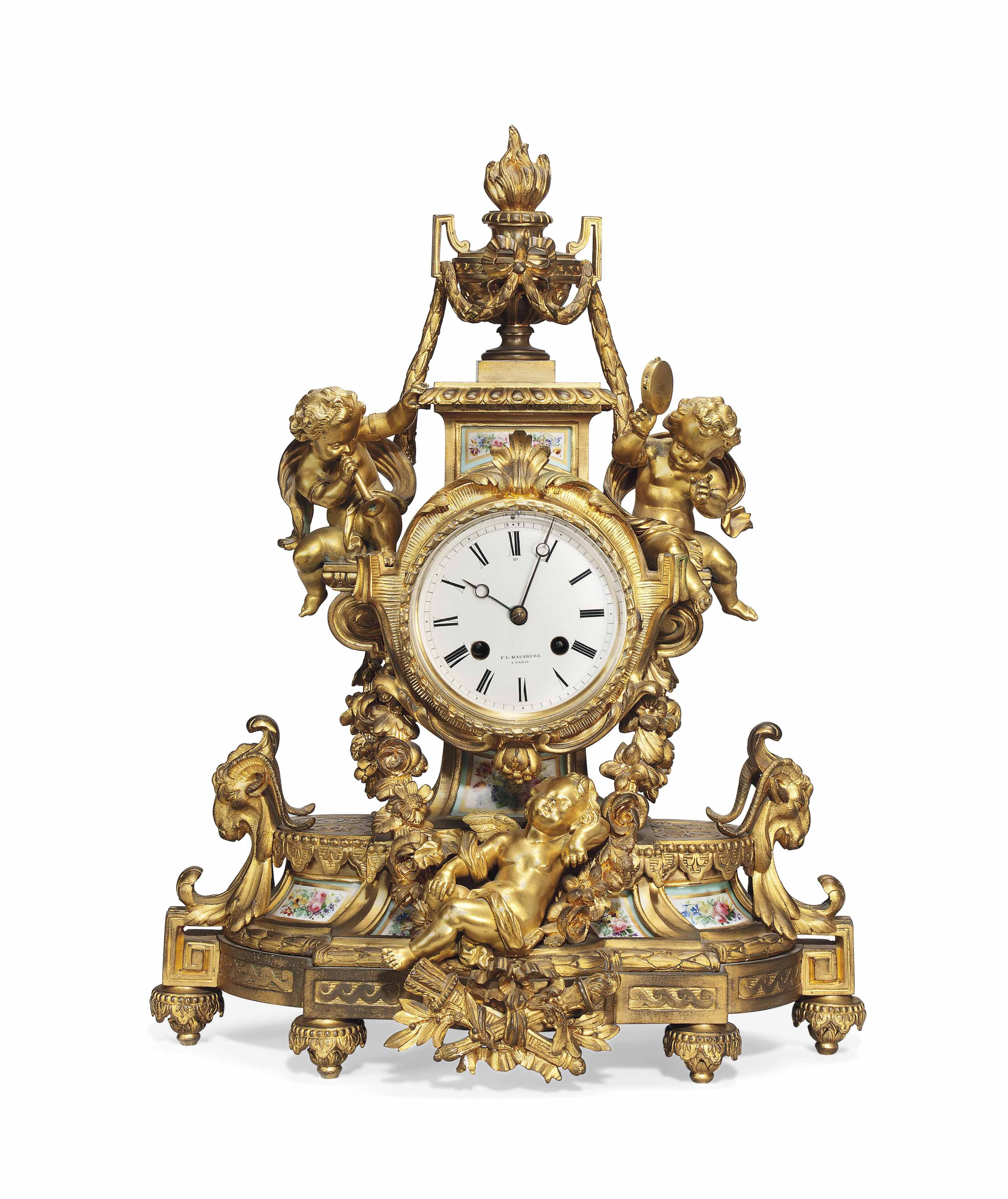 A FRENCH ORMOLU AND PORCELAIN-MOUNTED STRIKING MANTEL CLOCK