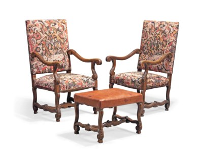 A PAIR OF CARVED OAK ARMCHAIRS