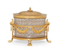 AN ENGLISH CUT-GLASS AND GILT-METAL BISCUIT BOX