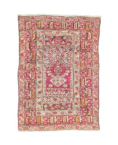 An antique Ghiordes prayer rug