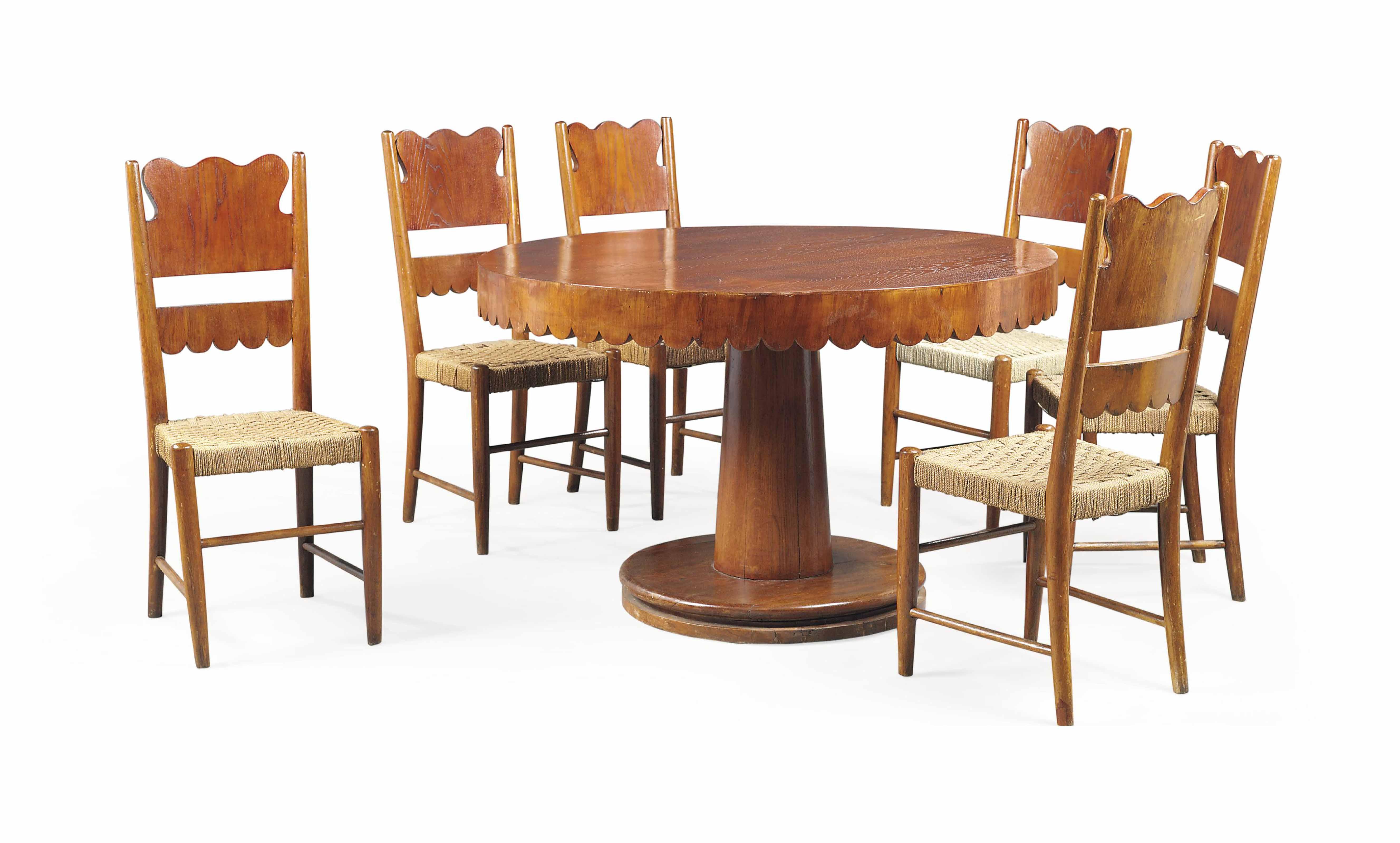 A PAOLO BUFFA (1903-1970) OAK DINNING ROOM SUITE