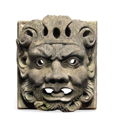 A CARVED STONE FOUNTAIN MASK