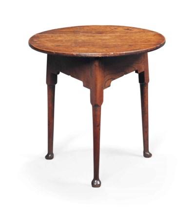 A GEORGE III OAK AND ELM TABLE