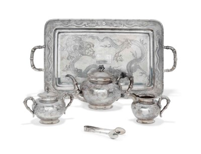 A CHINESE SILVER TEA SET AND A