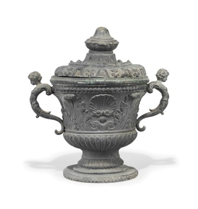 A LEAD URN AND COVER
