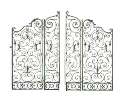 A PAIR OF ENGLISH WROUGHT-IRON