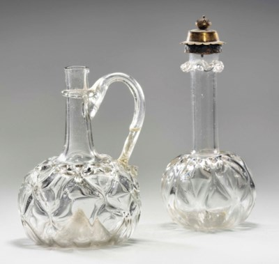 A MINIATURE GLASS FLASK AND SI