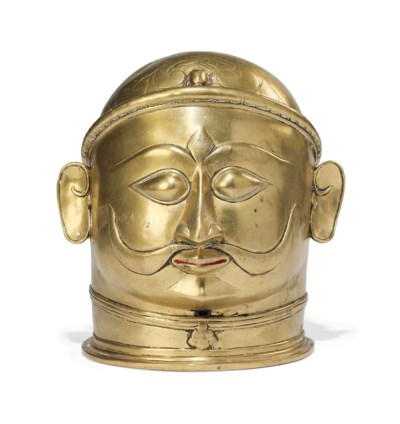 A LARGE BRASS HEAD OF MALE DEI