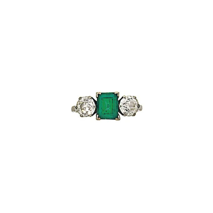 An emerald and diamond three s