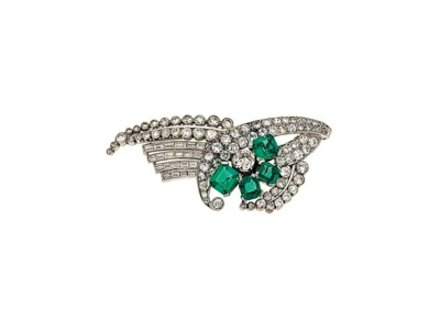 An emerald and diamond brooch
