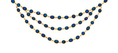 An 18ct gold and sapphire neck