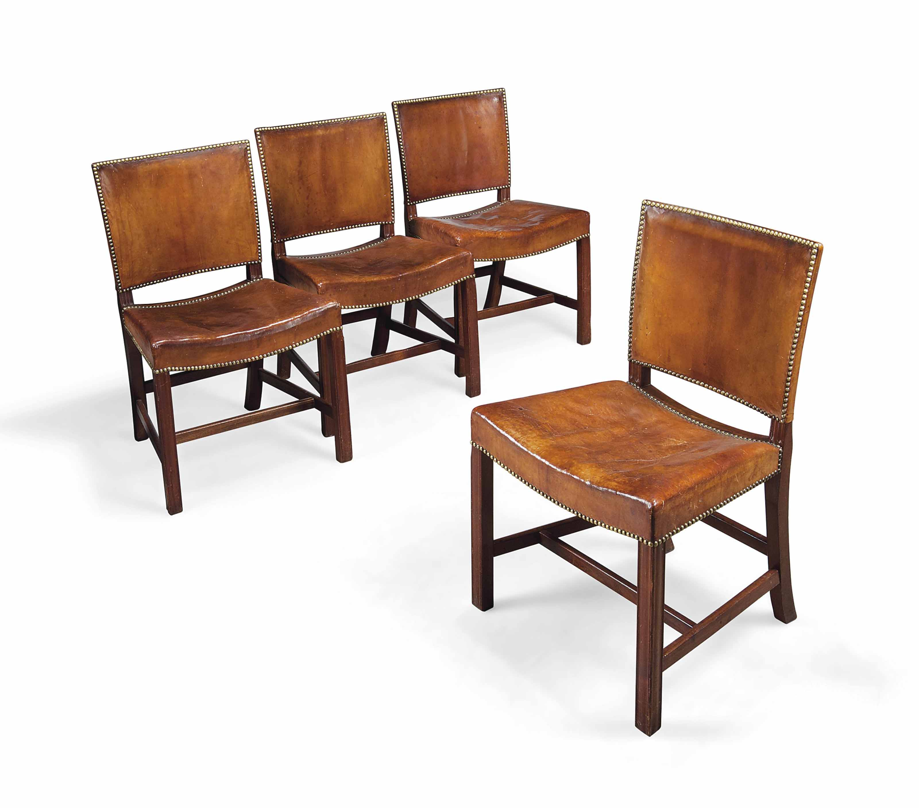 A SET OF FOUR KLINT KAARE (1888-1954) 'RED CHAIR' CUBAN MAHOGANY AND NIGERIAN LEATHER