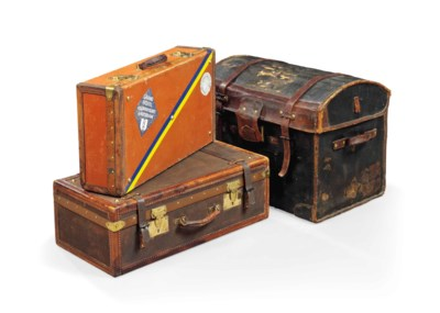 A DOMED LEATHER TRUNK AND TWO