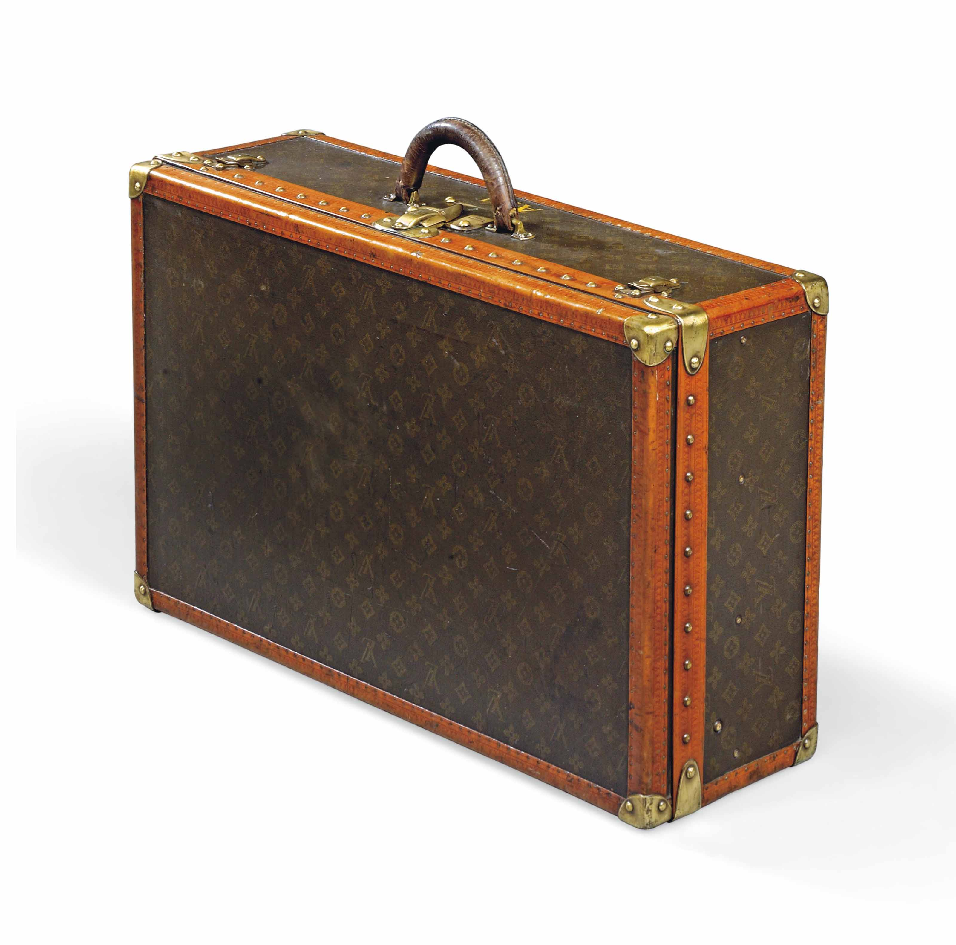 A HARD-SIDED ALZER SUITCASE IN