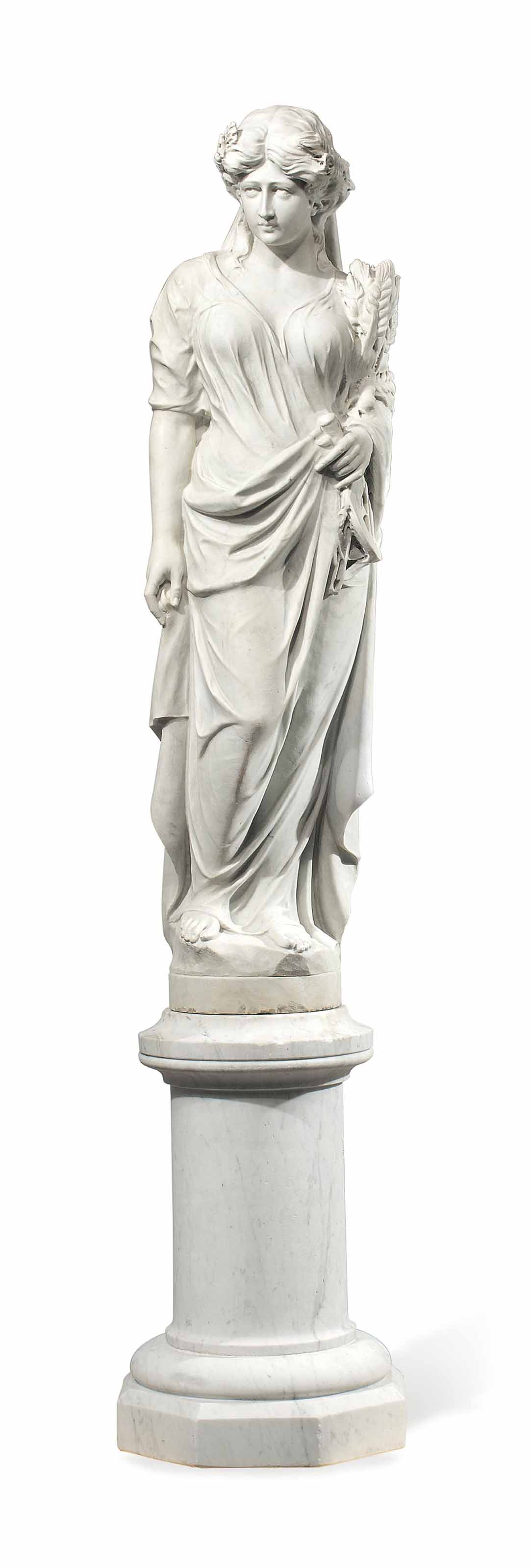 A CARVED MARBLE FIGURE OF A MA