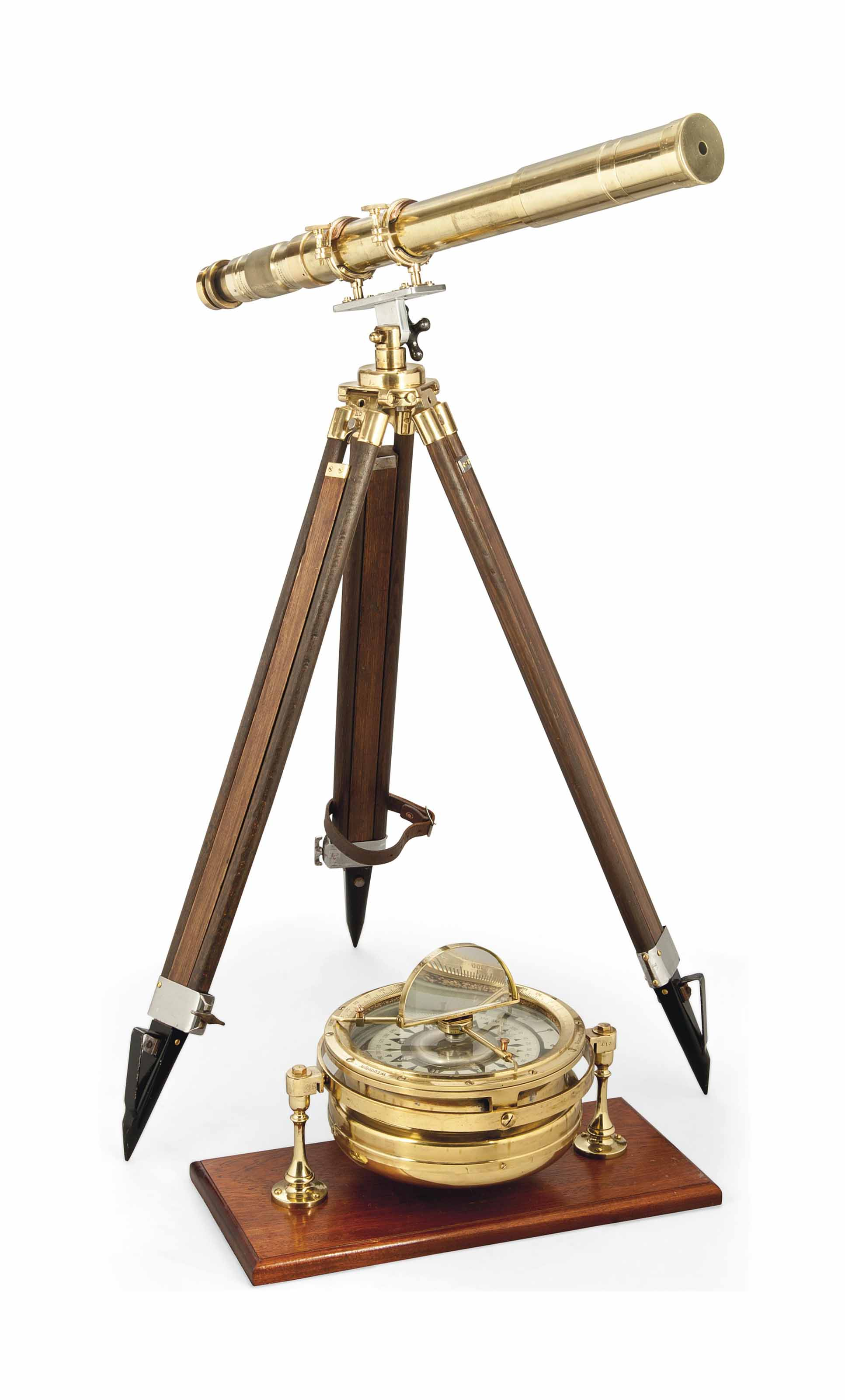 A BRASS SIGHTING TELESCOPE ON