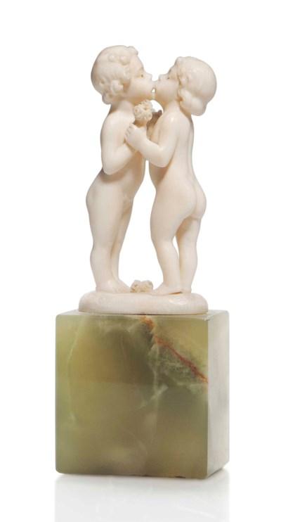 'FIRST KISS', AN IVORY FIGURE